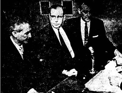 Otis T. Carr (Center)